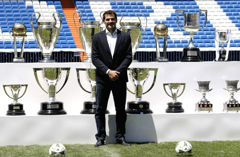 Spanish goalkeeper Iker Casillas poses during the insititutional farewell ceremony organized by Real Madrid at the honor box of Santiago Bernabeu stadium in Madrid, Spain, 13 July 2015. Casillas ...
