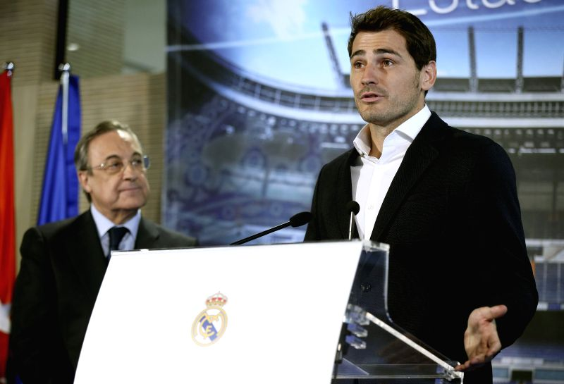 Spanish goalkeeper Iker Casillas (R) delivers his speech in presence of Real Madrid President Florentino Perez during the insititutional farewell ceremony organized by the club at the honor box of ...