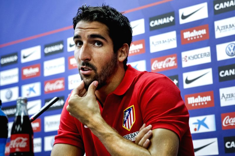 :Spanish team Atletico de Madrid's midfield Raul Garcia offers a press conference after a team training session in which he confirmed that nobody at the dressing room is talking about any ...