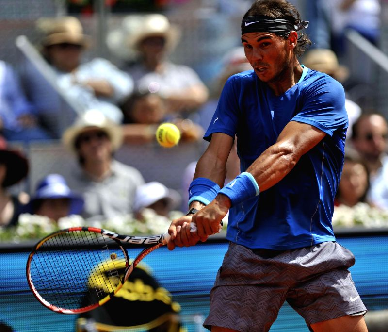 Spanish tennis player Rafael Nadal in action against Roberto Bautista Agut also from Spain during Madrid Tennis Open men's singles semi-final in Madrid, Spain on May 10, 2014. Nadal won. Score: 6-4, .