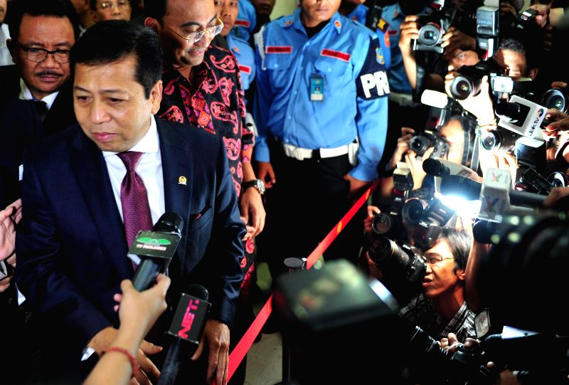 Speaker of Indonesia's House of Representatives Setya Novanto (L, front) speaks to media after his trial in Jakarta, Indonesia, Dec. 7, 2015. The trial is held by ...