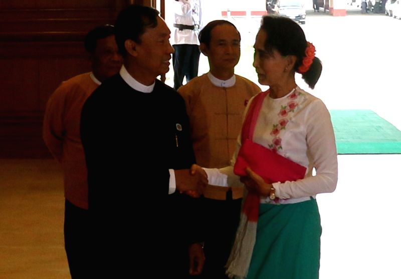 Speaker of Myanmar's Union Parliament and House of Representatives (Lower House) U Shwe Mann (L, front) shakes hands with Chairperson of Myanmar's National ...