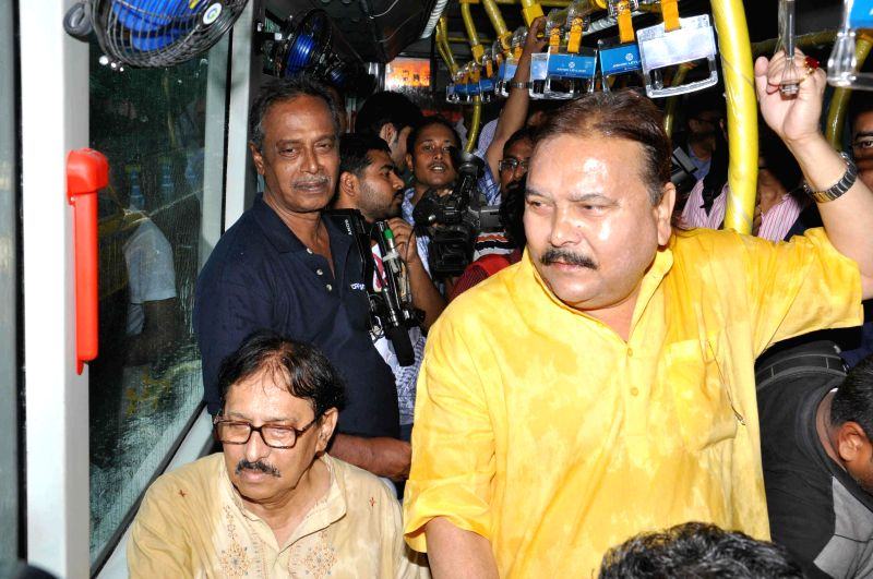 Speaker of West Bengal Assembly Biman Banerjee with West Bengal Transport Minister Madan Mitra during a programme organised to launch `Jan Bus` in Kolkata on July 30, 2014. - Madan Mitra