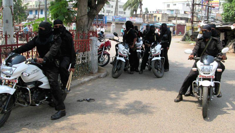 Special Operations Group (SOG) jawans in Naxalite affected Ganjam district of Odisha on April 10, 2014. (Photo : Arabinda Mahapatra/IANS)