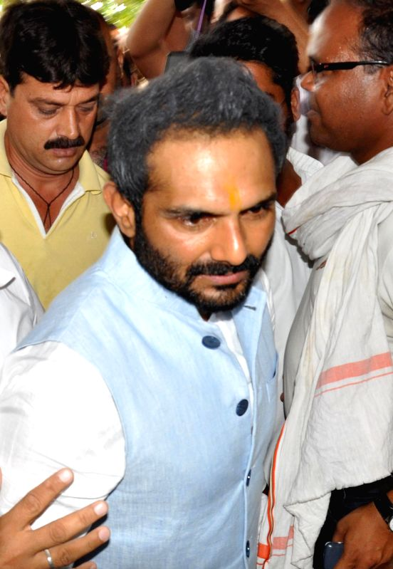 Special Task Force arrest Congress leader Sanjeev Saxena in Bhopal on May 12, 2014.