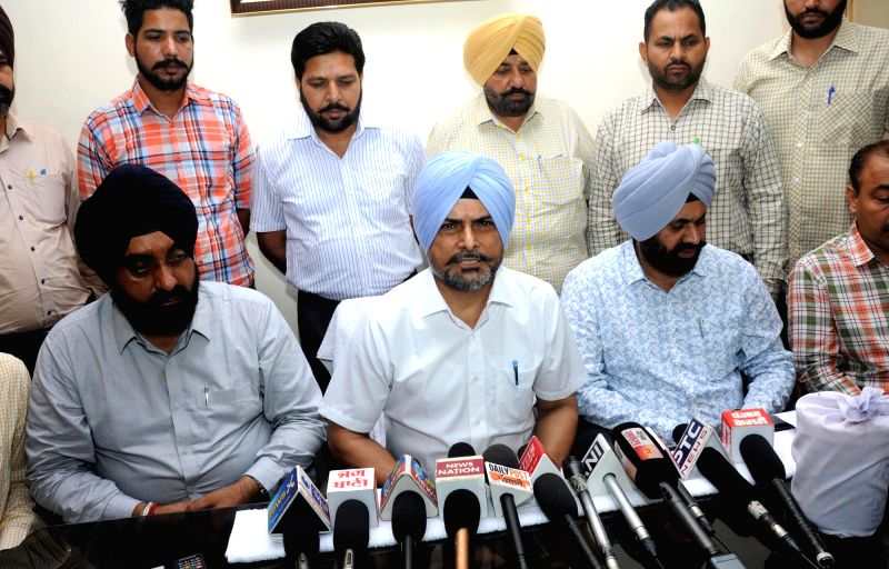 Special Task Force (STF) personnel address a press conference after a Ugandan woman was arrested for smuggling heroin, in Amritsar on July 21, 2018.