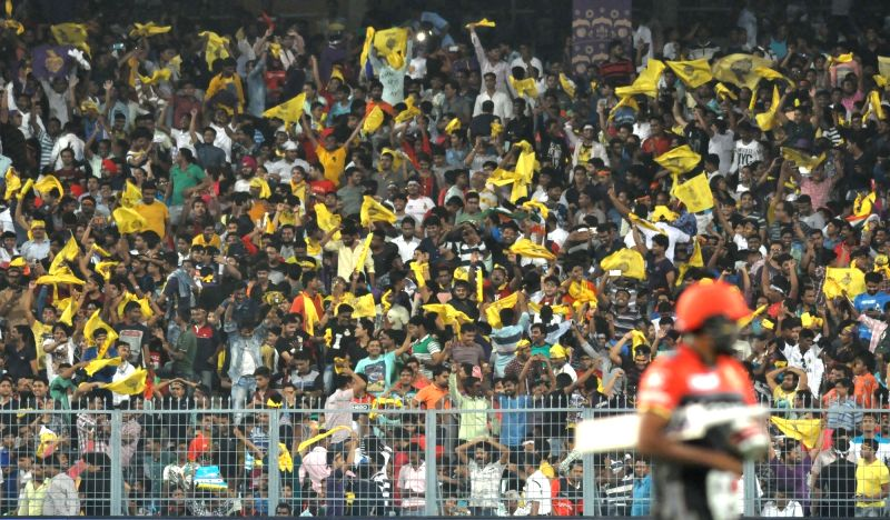 Spectators cheer during an IPL 2017 match between Kolkata Knight Riders and Royal Challengers Bangalore at Eden Gardens in Kolkata on April 23, 2017.
