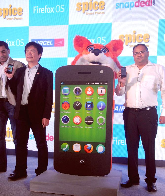 Spice Mobility Ltd. CEO Prashant Bindal and Senior Director of Mozilla Corp. James Ho launch a smartphone during a press conference in New Delhi on Aug 29, 2014.