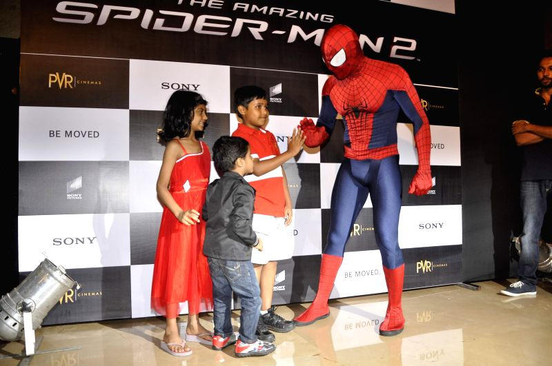 Spiderman with kids during the screening of Hollywood film The Amazing Spider-Man 2 in Mumbai, on April 29, 2014.
