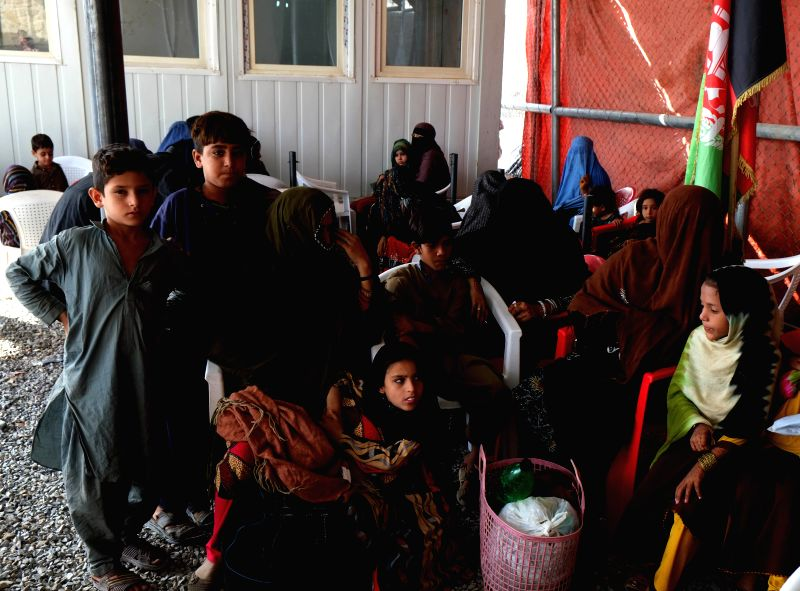 SPIN BULDAK (AFGHANISTAN), Oct. 12, 2017 Afghan people returning from Pakistan wait for trucks to go home at the Spin Buldak border of southern Kandahar province, Afghanistan, Oct. 12, ...
