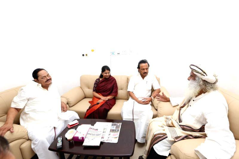 Spiritual guru Jaggi Vasudev with DMK leaders M.K. Stalin, Kanimozhi and Durai Murugan at Kauvery Hospital where DMK President M. Karunanidhi is admitted, in Chennai on July 30, 2018. ...