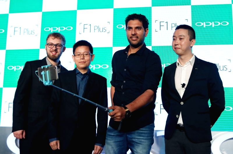 Sports Ambassador of OPPO cricketer Yuvraj Singh with OPPO Product Expert Marton Bracza and MD International Mobile Business and President OPPO India Sky Li during a press conference ... - Yuvraj Singh