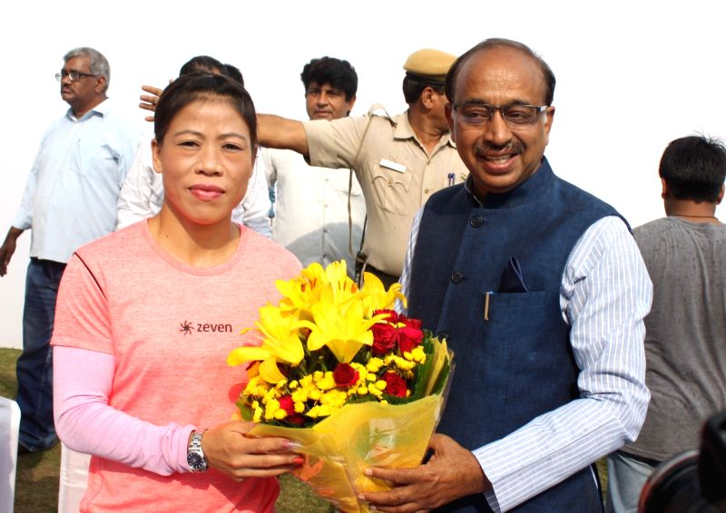 "Sports Minister Vijay Goel and boxer Marry Kom at the inauguration of ""Wall Of Wishes"" & ""Digital Campaign of Wishes"" for Indian Olympic Contingent in New Delhi, on ... - Vijay Goel"