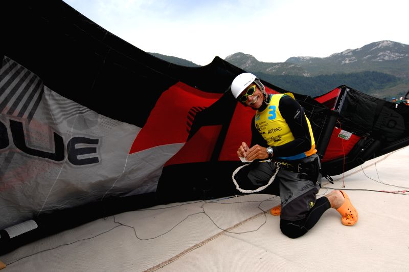Chris Glazier of Canada gets ready to compete on the opening day of 2014 West Coast Open International Kiteboarding Championship in Squamish, Canada, July 18, ...