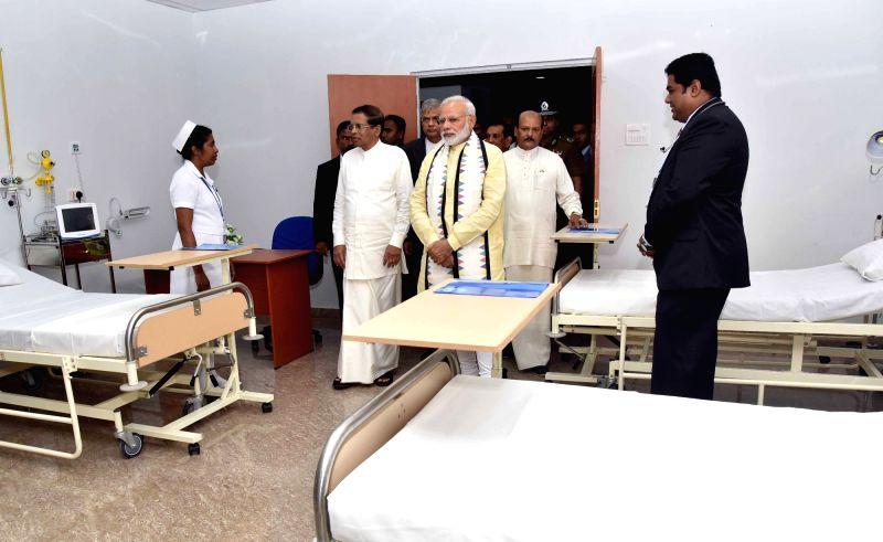 Sri Lanka: Prime Minister Narendra Modi visits after inaugurating the Dickoya Hospital Dickoya Hospital in Central Province of Sri Lanka on May 12, 2017. Also seen Sri Lankan President Maithripala ... - Narendra Modi