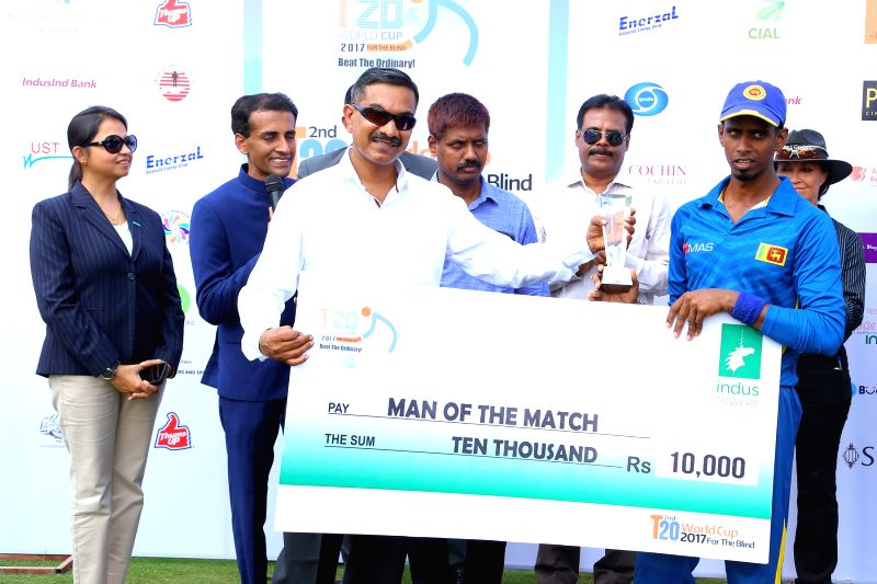 Sri Lankan player Suranga Sampath receives the Man of the Match award during post match presentation ceremony in Bengaluru on Feb 6, 2017.