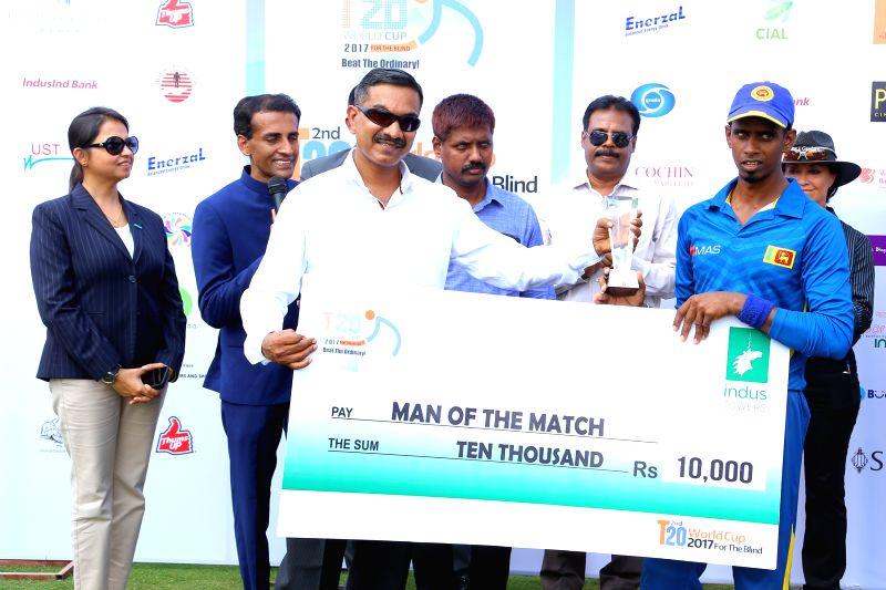 Sri Lankan player Suranga Sampath receives the Man of the Match award during post match presentation ceremony in Bengaluru on Feb 6, 2017.