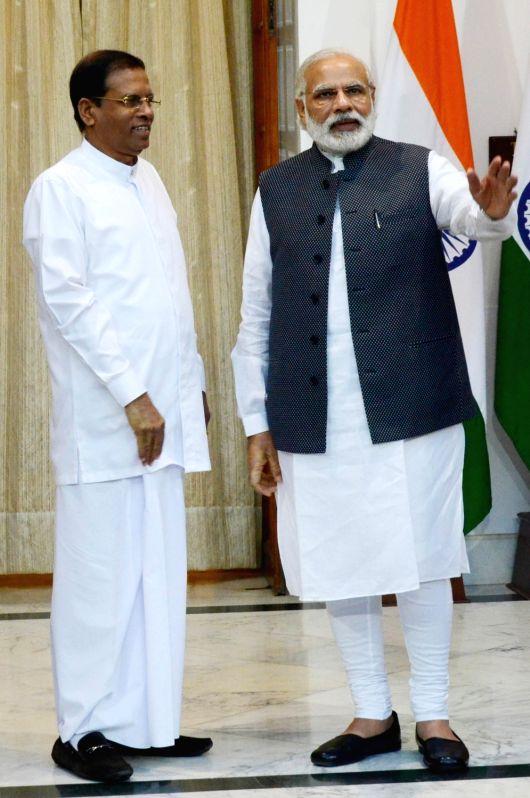 Sri Lankan President Maithripala Sirisena and Prime Minister Narendra Modi ahead of a meeting in New Delhi, on May 13, 2016. - Narendra Modi