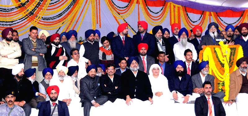 Sri Muktsar Sahib: Punjab Chief Minister Parkash Singh Badal addresses during a Shiromani Akali Dal conference in Sri Muktsar Sahib of Punjab on Jan 14, 2015. Also seen  Punjab Deputy Chief Minister . - Parkash Singh Badal and Sukhbir Singh Badal