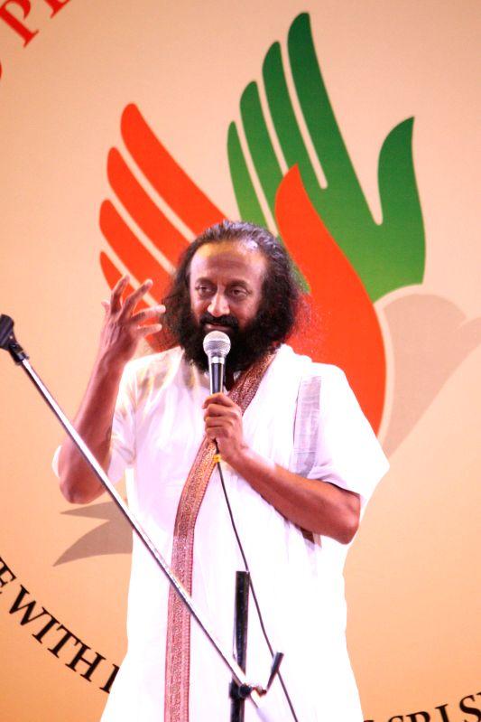 Sri Sri Ravi Shankar speaking on ``World Peace and Global Harmony`` at Jamia Millia Islamia in New Delhi on Aug. 30, 2014.
