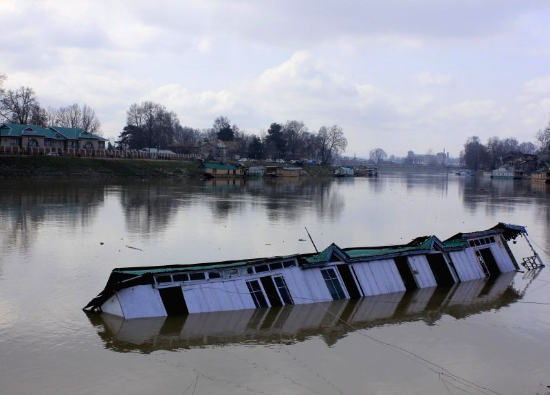 A houseboat capsizes in the Jhelum river in Srinagar, on Feb 26, 2015.