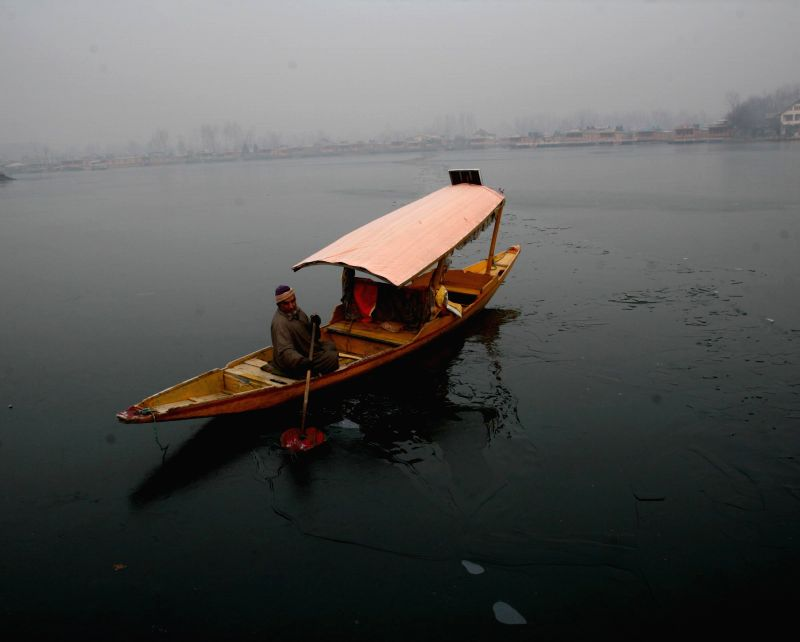 A shikara on frozen Dal lake during 'Chillai-Kalan' in Srinagar, on Jan 5, 2015.