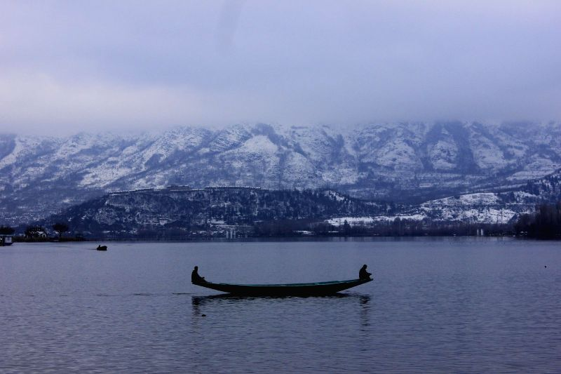 A view of Dal Lake after snowfalls in Srinagar, on March 3, 2015.