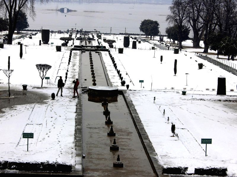 A view of snow covered Nishat Garden on the banks of the Dal Lake in Srinagar on Feb. 2, 2015.