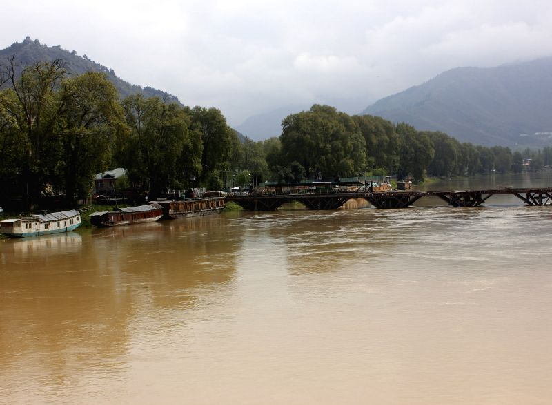 A view of swollen Jhelum river in Srinagar on April 21, 2015. The Jammu and Kashmir government has sounded flood alert in the city after incessant rains.