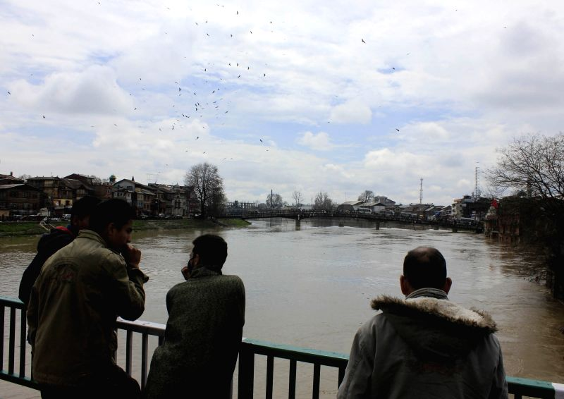 A view of swollen Jhelum river on March 30, 2015. The water level in the river has crossed the danger mark. Authorities Monday declared flood in the Kashmir Valley, asking people living ...