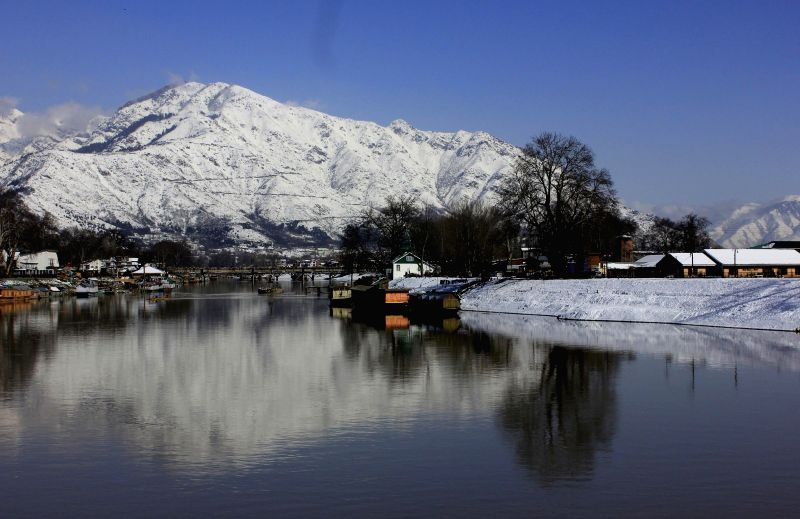 A view of the Jhelum river after snowfalls in the Kashmir Valley, in Srinaga.