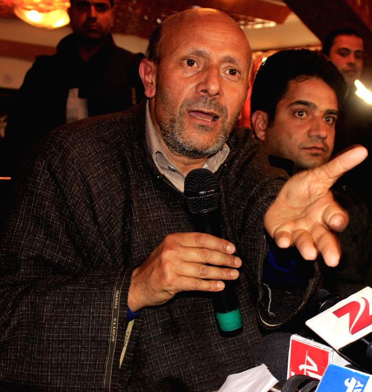 Awami Ittehad Party (AIP) chief Er. Rashid addresses a press conference in Srinagar, on Dec 26, 2014.