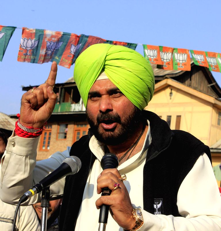 BJP leader Navjot Singh Sidhu addresses during an election campaign in Srinagar on Dec 10, 2014.