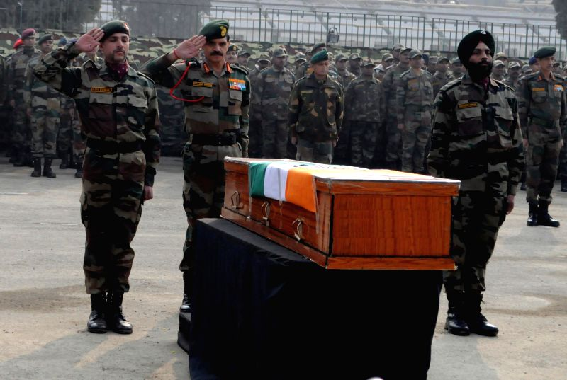 Chief of Army Staff, General Dalbir Singh pay tributes to the soldiers martyred on Friday`s attacks in Jammu and Kashmir at Muhara Uri Army camp, Badami Bagh Cantonment in Srinagar on Dec. .