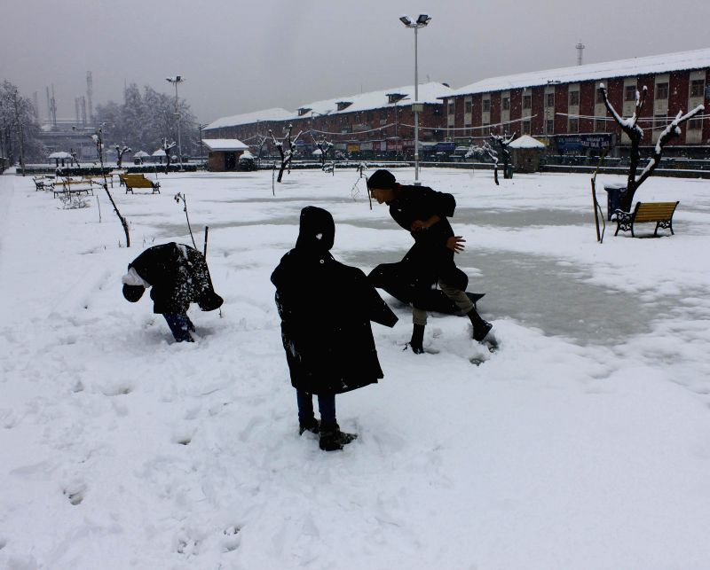 Children play in snow in Srinagar after Kashmir valley received heavy snowfalls on March 2, 2015.