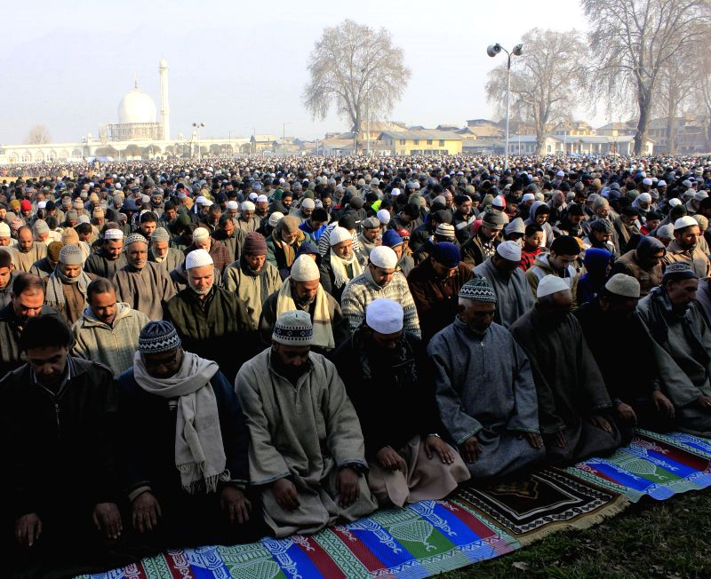 Devotees offer namaz at the Hazratbal Shrine on the first Friday after Eid Milad-un-Nabi in Srinagar, on Jan 9, 2015.