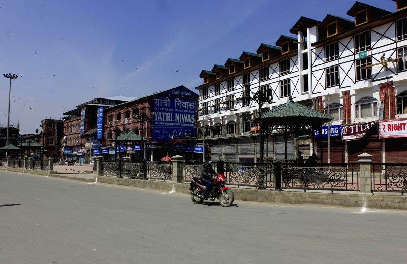 Empty streets due to a shutdown called by separatists against the government's proposal to set up a composite townships for displaced Kashmiri Pandits in Kashmir on April 11, 2015.