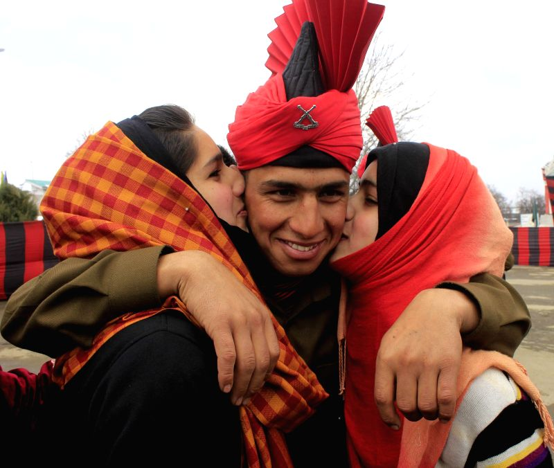 Family members of a new recruit during his passing out parade at the Bana Singh Parade Ground of Jammu and Kashmir Light Infantry Regimental Centre in Srinagar, on March 4, 2015.