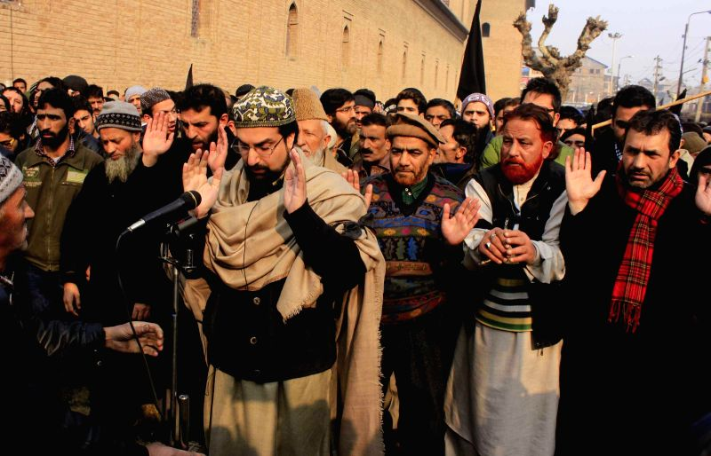 Hurriyat Conference (moderate faction) chairman  Mirwaiz Umar Farooq and others offer funeral prayers in absentia for the people killed in Tuesday's attack on the Army Public School in ...