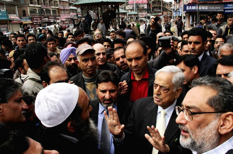 Jammu and Kashmir Chief Minister Mufti Mohammad Sayeed interacts with traders at Lal Chowk of Srinagar regarding floods on March 30, 2015. - Mufti Mohammad Sayeed