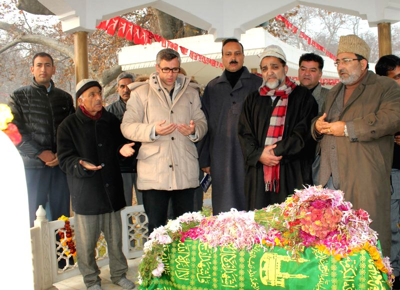 Jammu and Kashmir Chief Minister Omar Abdullah pays tribute to Sher-e-Kashmir Sheikh Mohammad Abdullah on his 109th birth Anniversary at Mazaar-e-Quaid in Hazratbal, Srinagar on Dec 5, ...