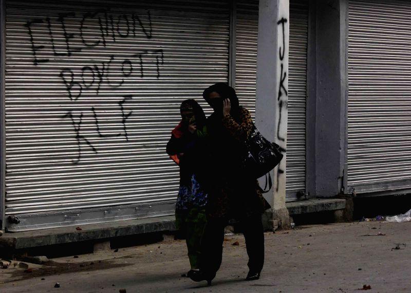 JKLF activist call for a shutdown to protest and boycott upcoming J&K Assembly Polls in Srinagar on Nov 22, 2014.