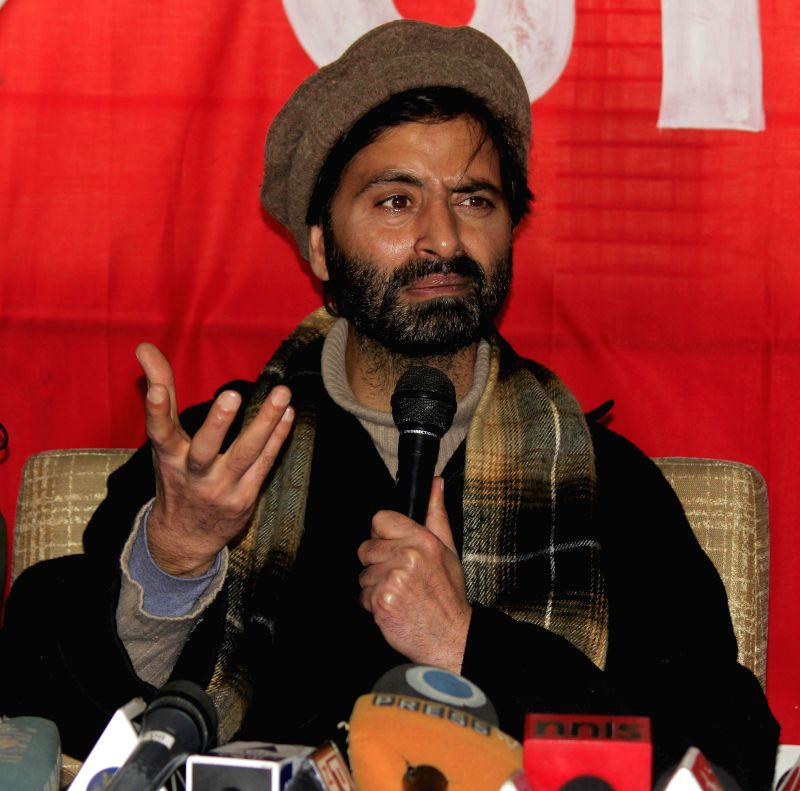 JKLF chairman Mohammad Yasin Malik addresses a press conference in Srinagar, on Feb 26, 2015.
