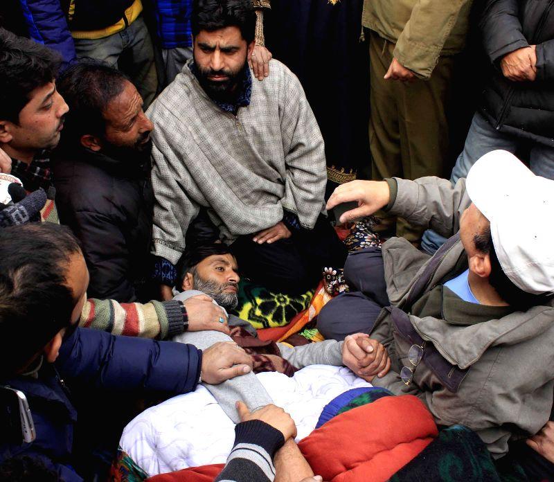 JKLF chairman Mohammad Yasin Malik goes on hunger strike against Jammu and Kashmir police in Srinagar on Dec 24, 2014. - Malik