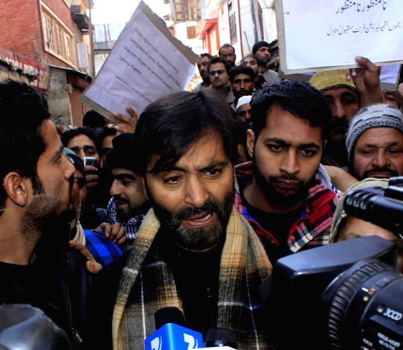 JKLF chairman Mohammad Yasin Malik leads a protest against the proposal to grant citizenship rights to refugees from West Pakistan settled in the Jammu region, in Srinagar on Jan 16, 2015.