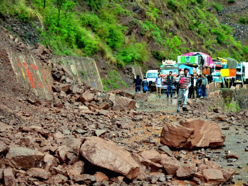 Srinagar - Muzaffarabad road blocked after a landslide near Lagama village in Uri sector of Jammu and Kashmir on May 2, 2014.