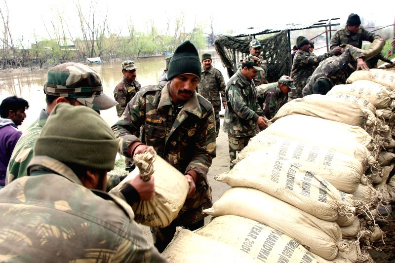 oldiers reinforce the banks of Jhelum river in the wake of flood alerts in Jammu and Kashmir, on April 2, 2015.