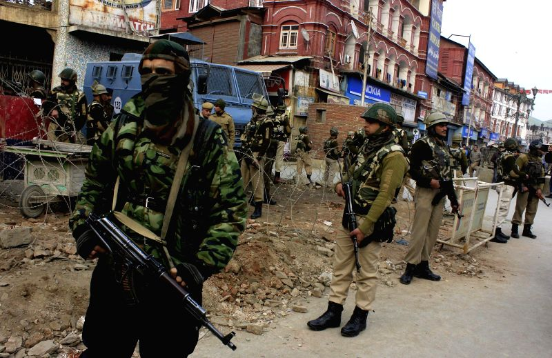 Paramilitary personnel stands guard after a grenade explosion which injured nine people, including a woman and two children at Lal Chowk in Srinagar on Nov. 29, 2014.