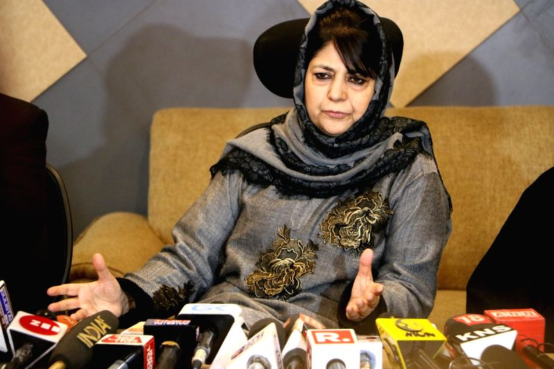 : Srinagar: PDP president and Former Jammu and Kashmir Chief Minister Mehbooba Mufti addresses a press conference in Srinagar, on Dec 7, 2018. (Photo: IANS).(Image Source: IANS)