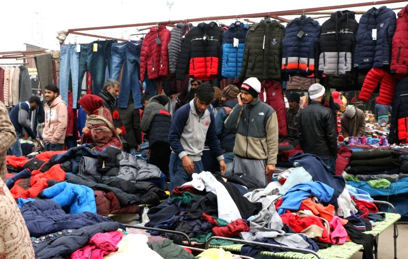 Srinagar: People busy buying warm clothes at a market in Srinagar, on Dec 18, 2018. An intense cold wave continued in the Kashmir Valley and the Ladakh region on Tuesday, dropping the minimum temperatures below the freezing point.